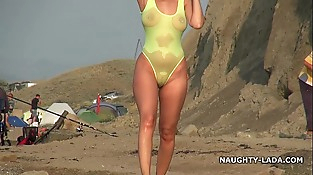 Semitransparent swimsuit and nude on the beach