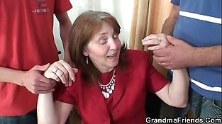 Big-titted granny in stockings rides and deep throats at same time