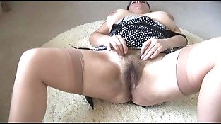 Curvy busty mature lady with big hairy pubic hair strips and teases