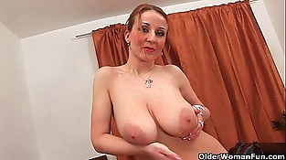 Soccer mom with natural big tits and well used cunt