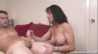 Brunette Mummy Topless Handjob